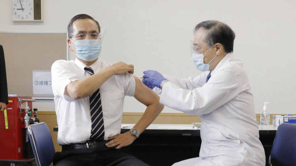 Japan launches COVID-19 vaccinations as Olympics approach